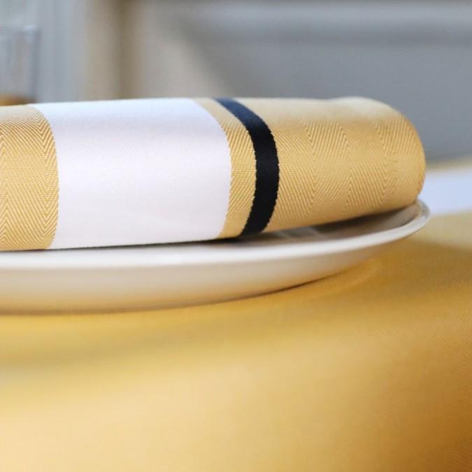 Serviette de table Donibane couleur Laiton en coton chevron